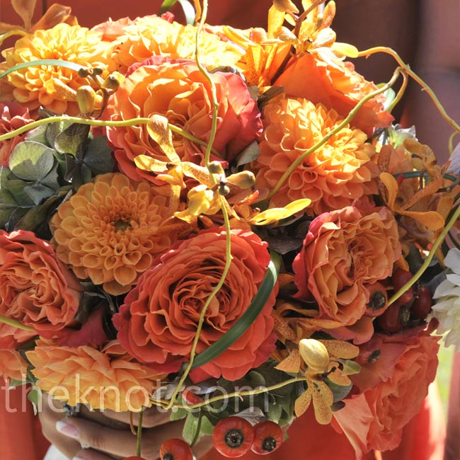 Tyler's bouquet was made up of orange Mokara orchids, garden roses and dahlias with accents of curly willow.