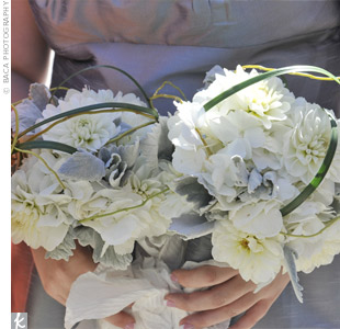 The bridesmaids carried white bouquets of dahlias, hydrangeas and dusty miller looped with bear grass.