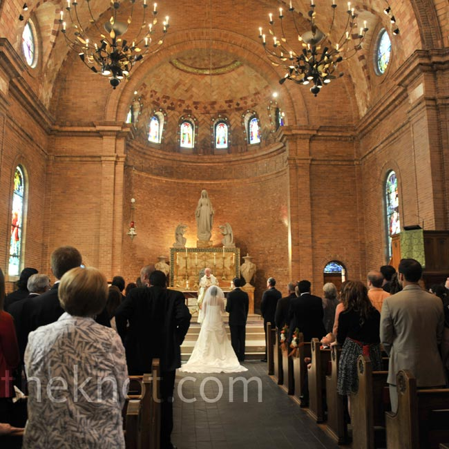 The church's soaring ceilings and dramatic chandeliers were all the decor needed for Tyler and Brian's Catholic ceremony.