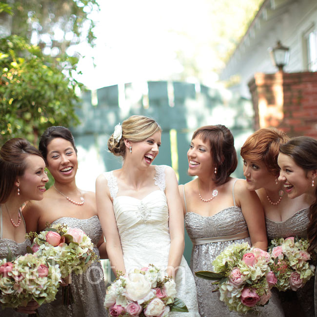 The bridesmaids' pink pearl and cameo necklaces were an unexpected accent to their silver lace dresses. Their vintage look complemented Bethany's lace gown.
