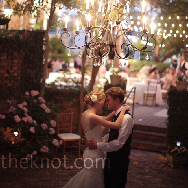 "A chandelier cast a romantic glow as Bethany and Matt shared their first dance to an instrumental version of Aladdin's ""A Whole New World"" by John Tesh."