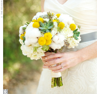In keeping with the rustic, Southern feel of the wedding, the bridal bouquet was made up of cotton bolls, craspedia and succulents with a few soft white flowers.