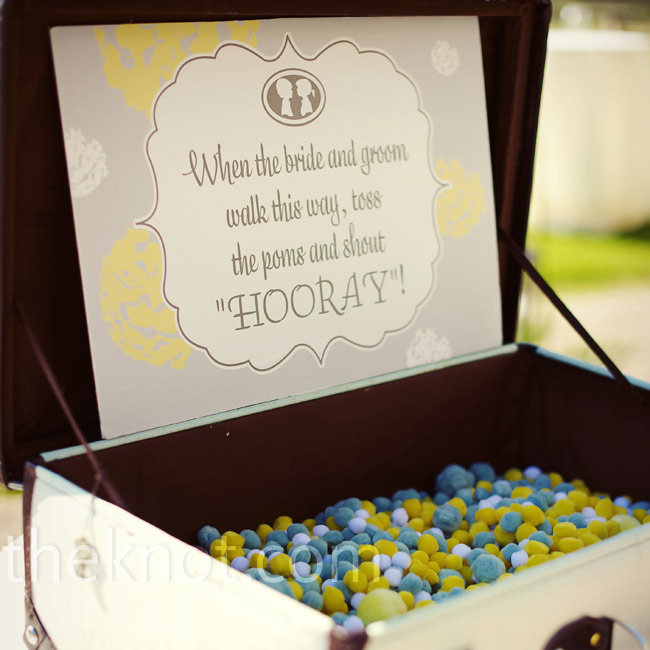 A vintage suitcase was filled with gray, yellow and white poms for guests to toss as Bonnie and Matthew exited the reception.