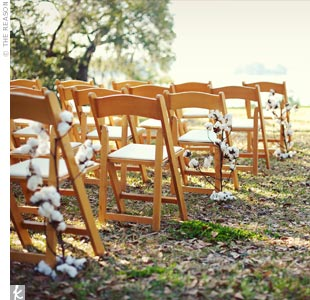 The ceremony décor was kept simple with cotton branches climbing every other chair down the aisle.