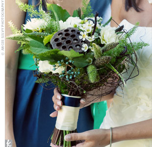 Courtney carried a mix of natural elements (like acorns, lotus pods and birch) in her bouquet.