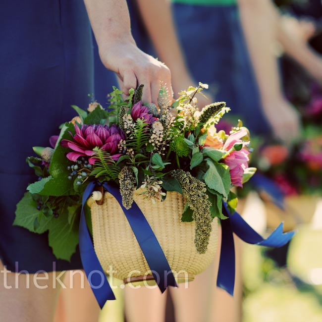 In true Nantucket fashion (Andrew grew up there), the bridesmaids carried lightship baskets of flowers.