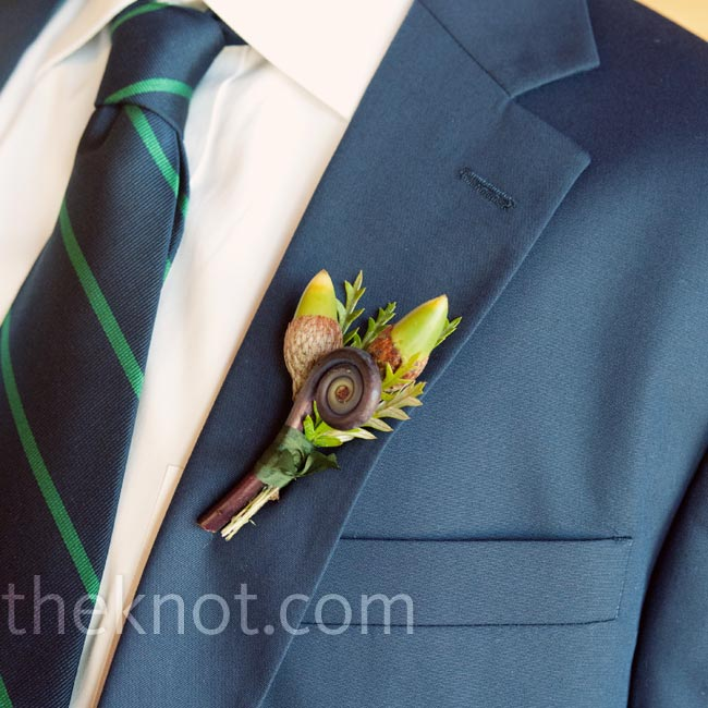Andrew paired his navy blazer with a boutonniere of flower buds and a fiddlehead fern.