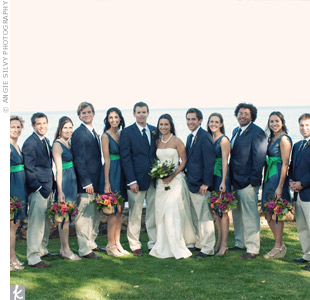 The bridesmaids wore navy dresses with green sashes, while the guys matched in navy and green striped ties.
