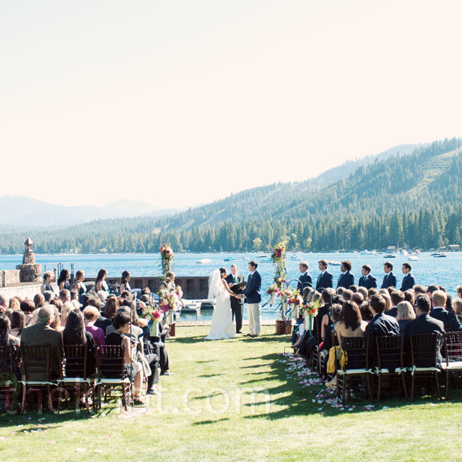 The ceremony took place right on Lake Tahoe, with the ski slopes in the backdrop. Simple flower arrangements kept the focus on the view.
