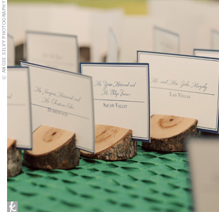 The cards were placed in the slits of small, angled wooden stumps, which guests could take home to use as picture-holders.