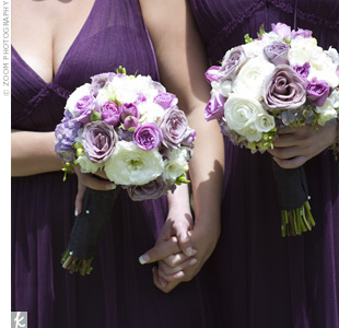 The girls held white and purple bunches of lilacs, peonies and roses to go with their dresses.