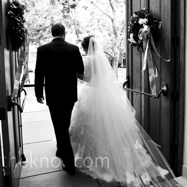 To match her dress, Jillian chose a cathedral-length veil with organza flowers sewn at the bottom.