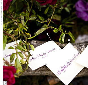 The calligraphed escort cards were pinned to a flower-covered birch log for a natural, romantic look.
