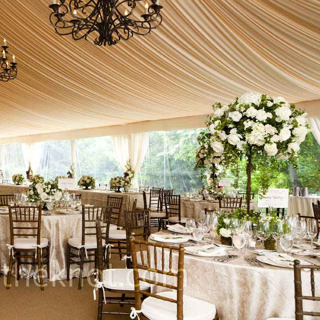 Neutral décor (embroidered ivory linens, lush white flowers and wrought iron chandeliers) dominated beneath the dinner tent.