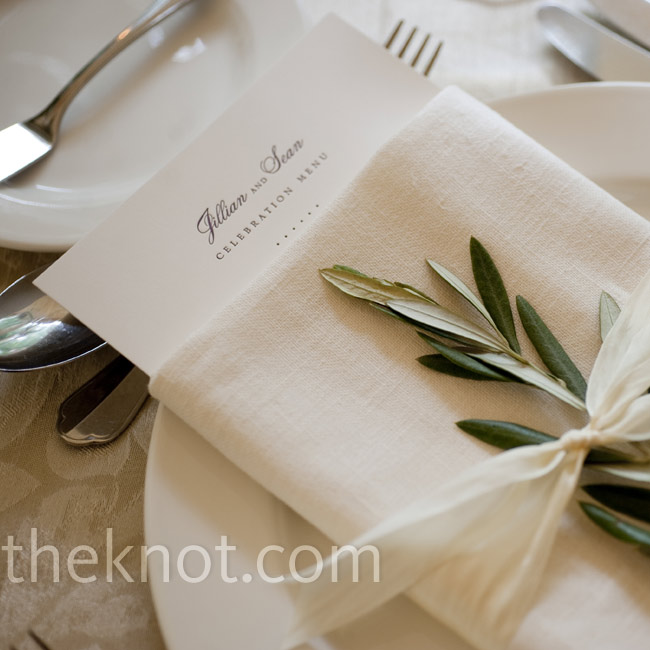 A sprig of leaves tucked into each napkin gave the place settings a pretty, natural touch.