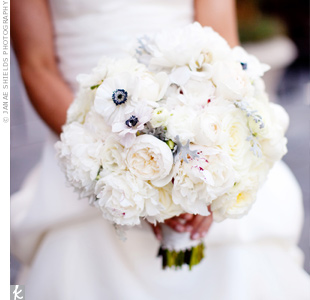 Dusty miller added extra texture to Kate's all-white bouquet of ranunculus, peonies, anemones, garden roses and tea roses.