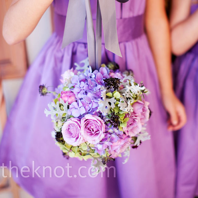 The flowers girls carried small pomanders of roses, hydrangeas, sweet peas and dusty miller to match the bridesmaid bouquets.