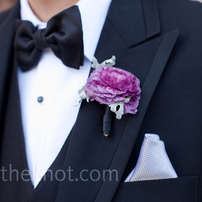 To complement their sharp tuxes, each groomsman wore a single ranunculus bloom on his lapel.