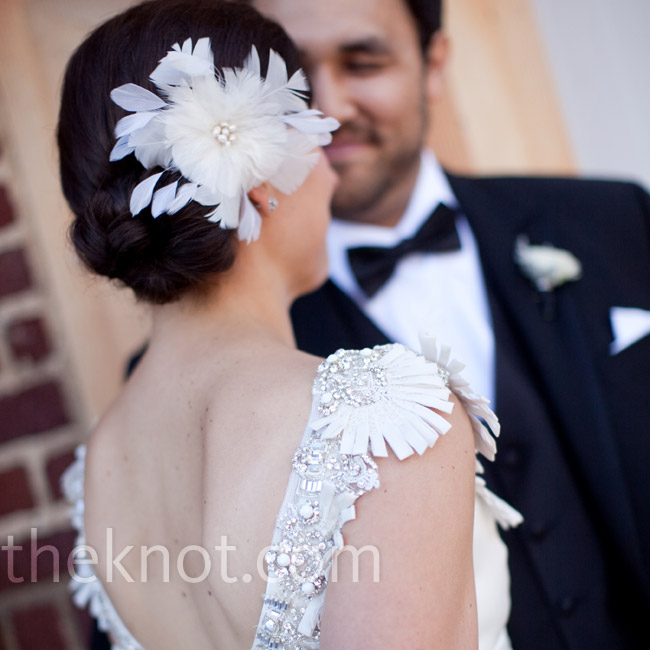 The feather and pearl fascinator Kate wore during her ceremony evoked the intricate neckline of her gown.