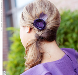 The bridesmaids finished their looks with purple tulle flower hairpins.