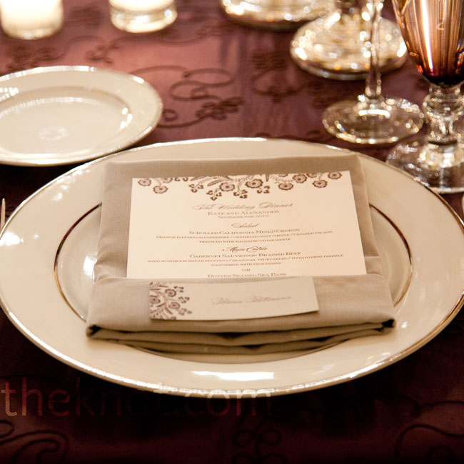 Elegant chargers and silverware kept with the theme, and the menu cards matched the invitations.
