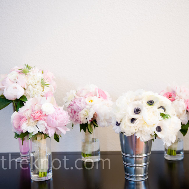 Kimberly wanted all of the flowers to be soft and romantic, so she had the bridesmaids carry pale peonies and roses.