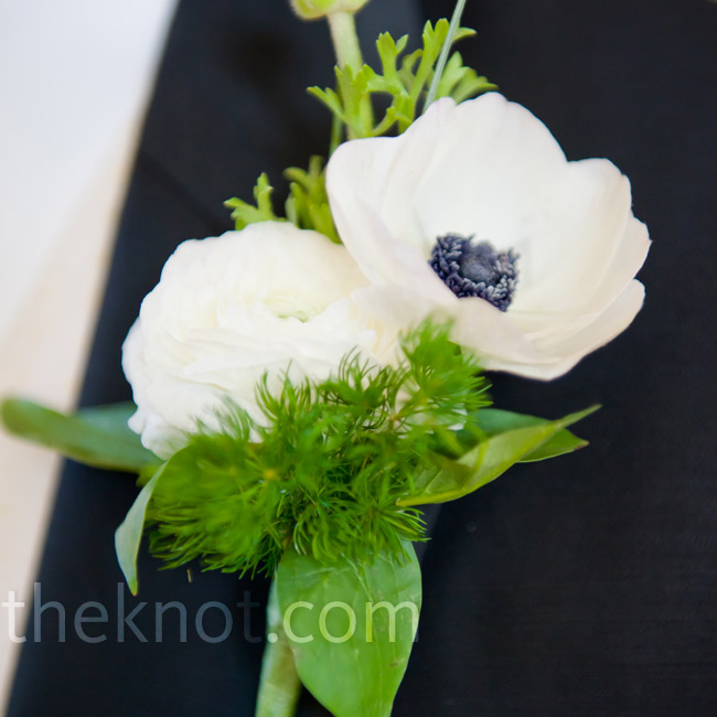 Tony wore a ranunculus and anemone with mixed greens on his lapel to match Kimberly's bouquet.