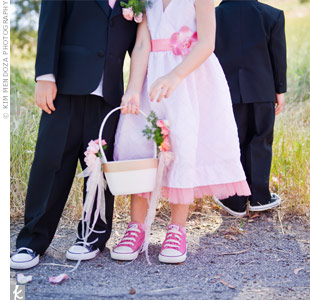 Even the flower girl got a pair of Converse sneakers. She carried a satin basket filled with fresh petals.
