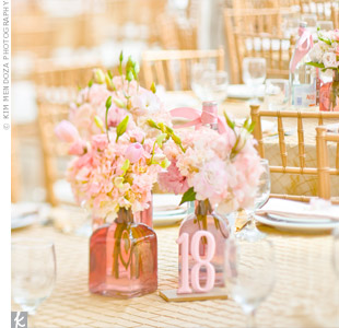 Champagne-colored linens and low key flowers kept pink from overpowering the reception.