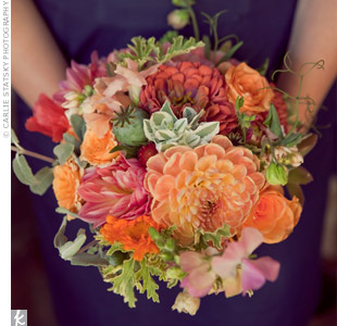 The bridesmaids carried orange and pink blooms accented with greens.