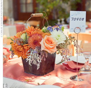 Their florist used copper buckets to add a homey and organic look to the tables.