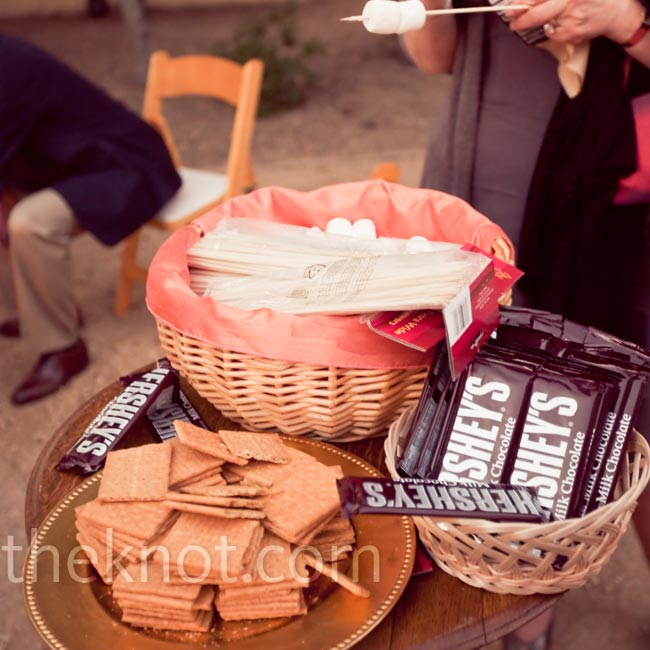 Guests helped themselves to a make-your-own-s'mores station set up near the fire pits.