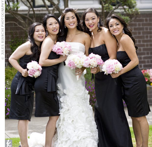 The bridesmaids wore black, strapless dresses while Vys maid of honor stood out in a Jim Hjelm floor-length gown.