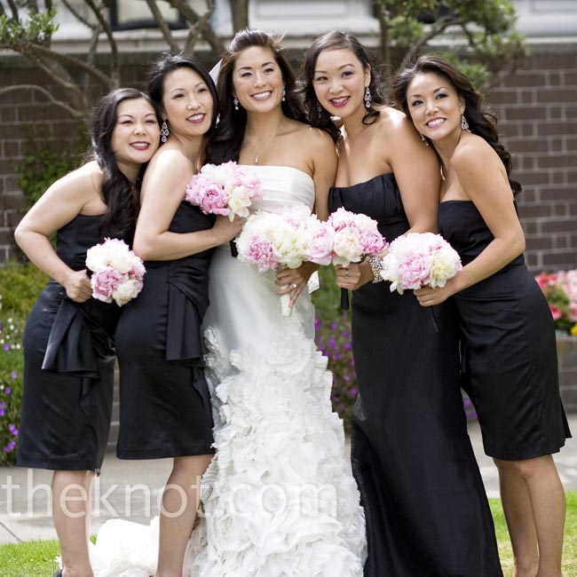 The bridesmaids wore black, strapless dresses while Vy's maid of honor stood out in a Jim Hjelm floor-length gown.