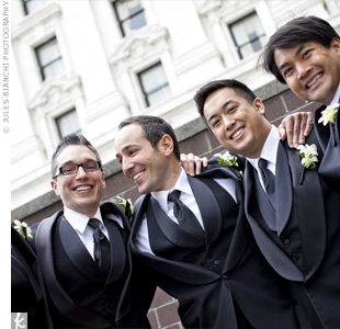 Leonard, along with all his groomsmen, wore matching tuxes, black vests and ties.