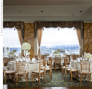 To complement the Crown Rooms existing pastel d&#233;cor, Vy and Leonard went with neutral table settings.
