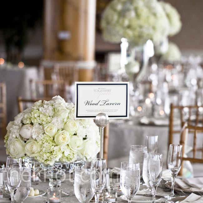 Arrangements full of ivory and pale pink flowers topped the dinner tables.