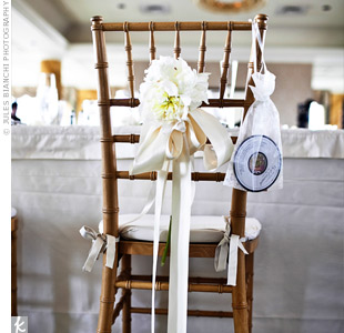 The same simple blooms from the ceremony chairs hung from the chairs of guests seated at the head table.