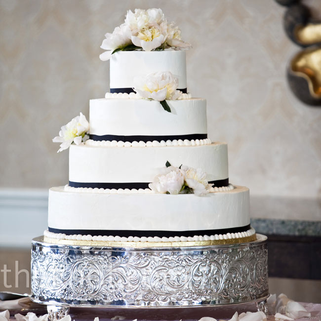 Pearl piping, black ribbon and pink peonies decorated the four-tiered cake.
