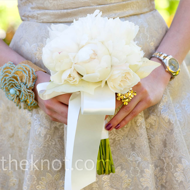 The bridesmaids carried smaller versions of Anna's white peony bouquet.