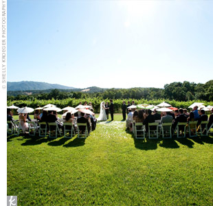 The ceremony took place on the lawn, facing the vineyards and mountains.