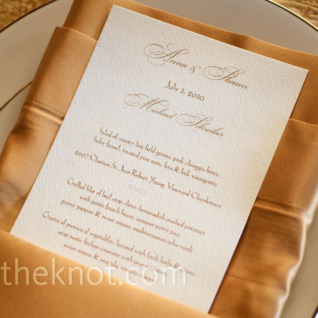 Elegant script font in gold ink gave the perfect formal look to the menu cards.