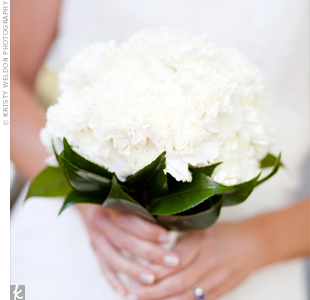 Eileen carried a bouquet of all-white carnations accented with camellia leaves.