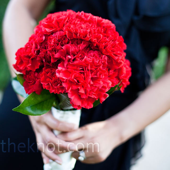 With help from her mom and sister, Eileen assembled all of the bouquets. The bridesmaids carried tightly packed red carnations.