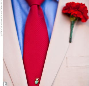 Justin and the guys all wore single red carnation blooms.