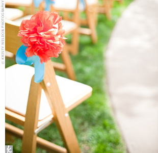 Tissue-paper flowers marked the chairs along the ceremony aisle.