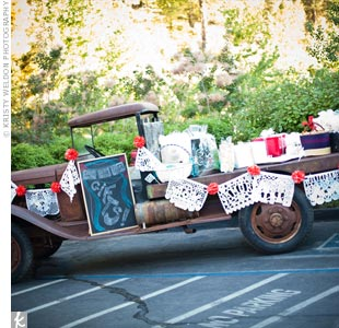 An antique truck decked out with a papel picado (perforated paper) banner served as the gift table.
