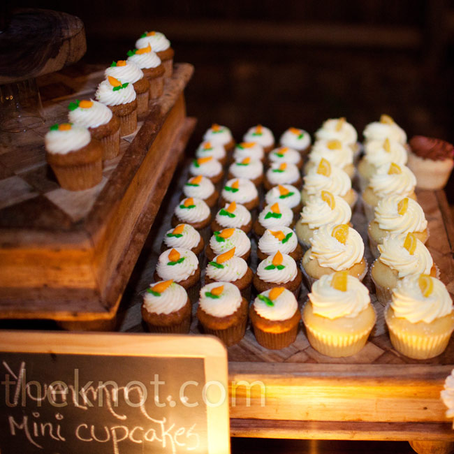Jenna and Anthony served various cupcakes on wood cheese boards surrounded by candles.
