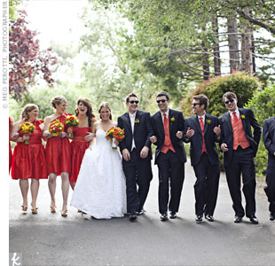 Tomato-colored bridesmaid dresses fit in with the wedding's color palette, and the guys coordinated in persimmon vests and ties.