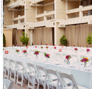 The reception took place in the hotel's courtyard with twinkle lights strung above the banquet tables.